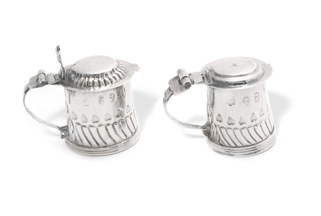 Two Queen Anne silver miniature tankards by George Manjoy, London 1702 and 1704