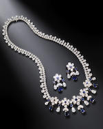 A sapphire and diamond flower necklace and earring suite, by Graff