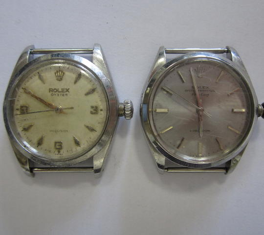 A lot of two stainless steel watch heads by Rolex (AF)