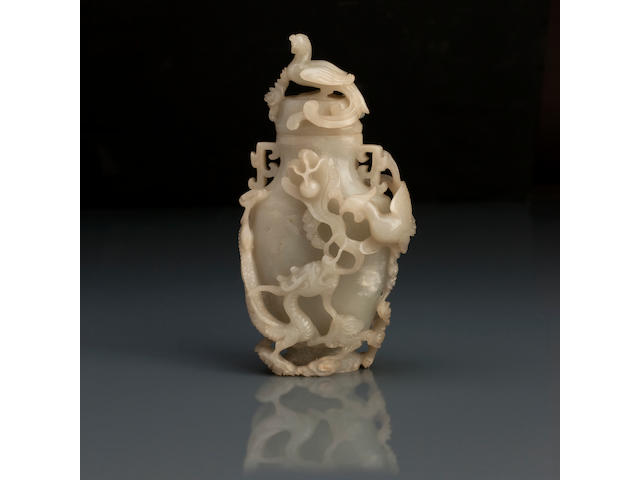 A pale jade vase and cover