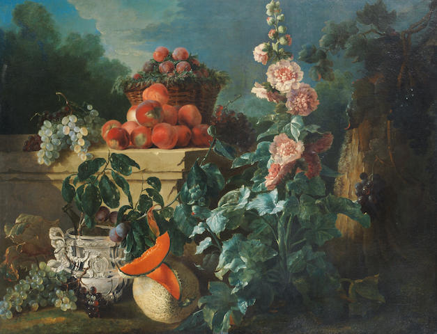 Jean-Baptiste Oudry (Paris 1686-1755 Beauvais) A still life of grapes, peaches and a basket of plums on a stone ledge above a silver wine cooler beside a split melon and a pink hollyhock in a wooded park