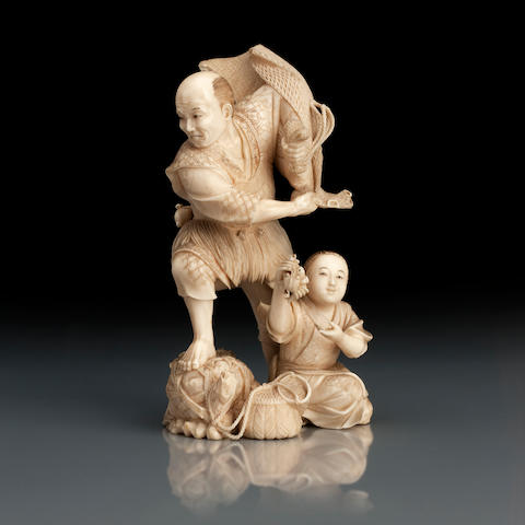 A carved ivory okimono of a fisherman and his son Meiji, signed Ichishin
