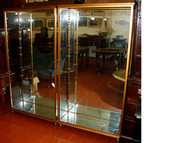 A pair of gilt painted metal framed glazed display cabinets,