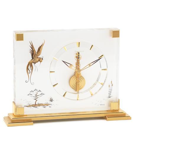 Jaeger-LeCoultre. A brass and lucite 8 day desk clock Marina, Ref:350, Circa 1960