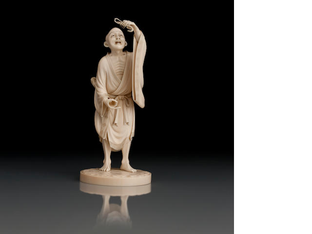 An ivory okimono of a lobster fisherman Meiji, signed Yasumune