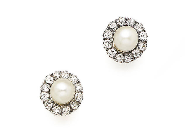 A pair of natural pearl and diamond cluster earrings