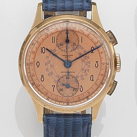 Chronographe Suisse. A gold manual wind chronograph wristwatch Case No.520073, Circa 1950