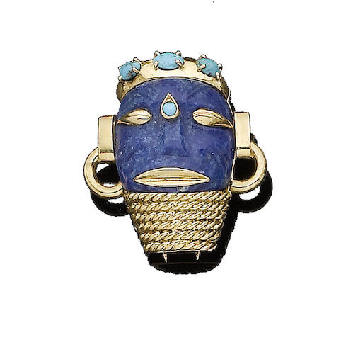 A lapis lazuli and turquoise tribal mask brooch, by Cartier,