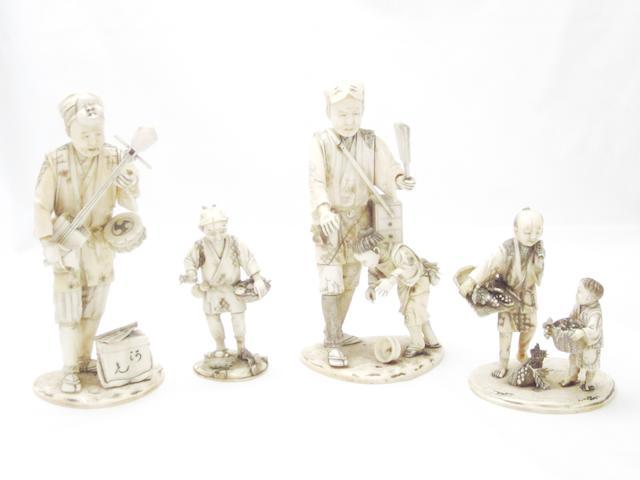 Four signed sectional ivory okimono Meiji