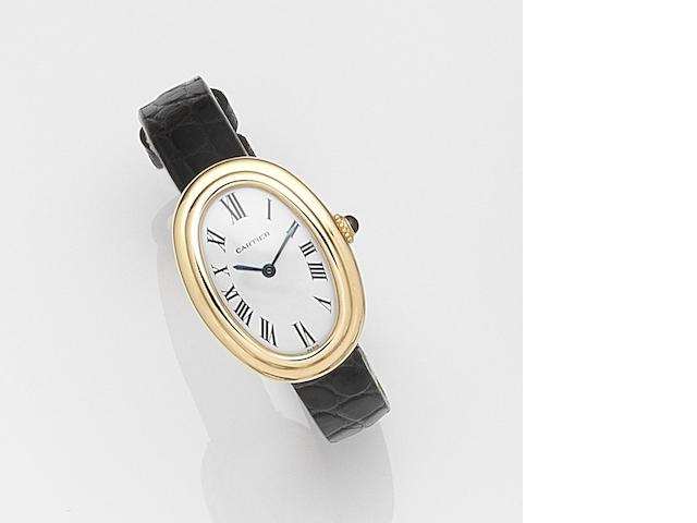 Cartier. A lady's 18ct gold manual wind wristwatch Baignoire, Case No.780942999, Circa 2000