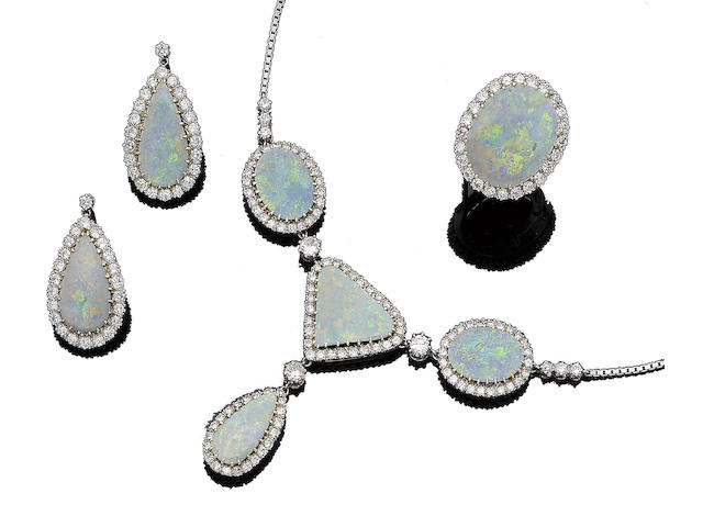 An opal and diamond necklace, pendent earring and ring suite (3)