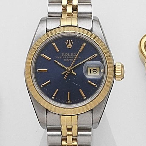 Rolex. A lady's stainless steel and gold automatic calendar bracelet watch Date, Ref:69173, Serial No.L47****, Movement No.124****, Circa 1989