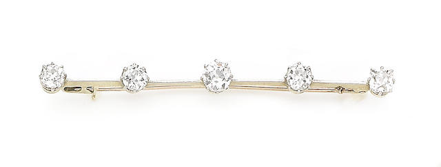 A diamond five-stone bar brooch,