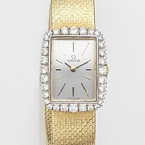 Omega. A lady's 18ct gold and diamond set manual wind bracelet watch Ref:8101, Case No.680497, Movement No.24378221, London Hallmark for 1987