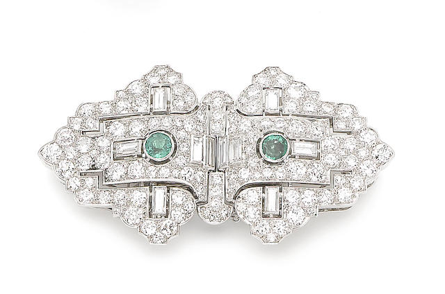 An emerald and diamond double clip brooch
