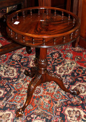 A modern reproduction George III style mahogany wine table