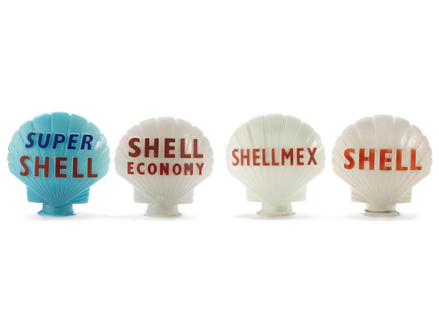 A set of four Shell glass petrol pump globes,