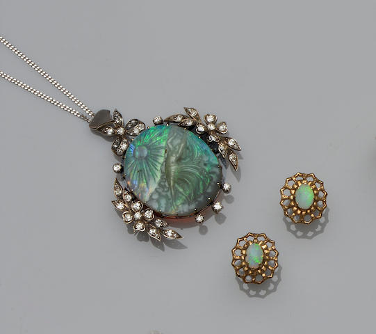 A carved opal and diamond brooch/pendant and a pair of opal earstuds (2)