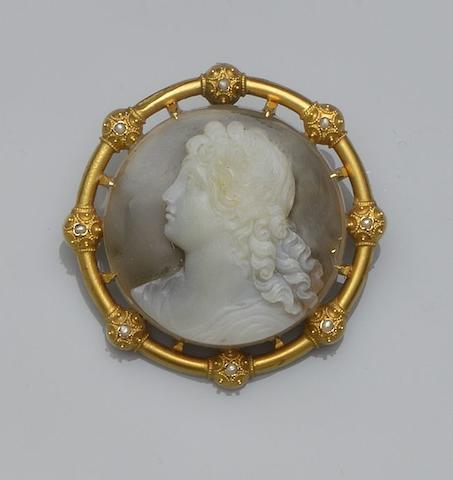 A 19th century hardstone cameo and seed pearl brooch/pendant