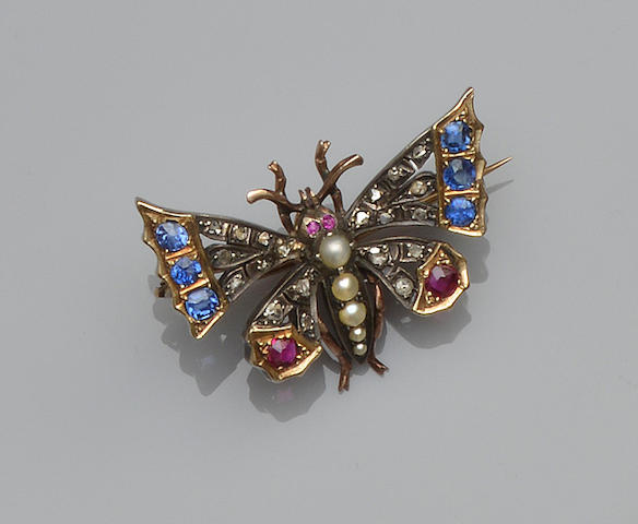 A late Victorian gold and silver mounted gem set butterfly brooch