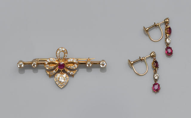 A ruby and diamond bar brooch and a pair of ruby and diamond earpendants (2)