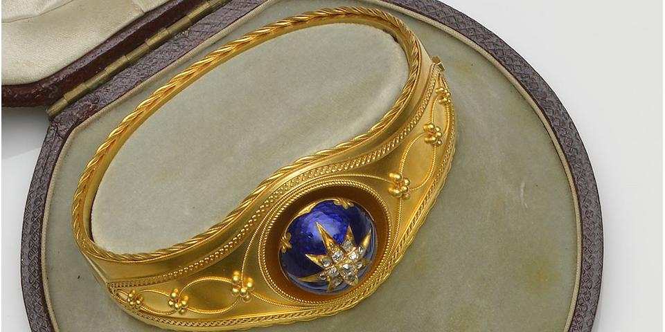 A mid-19th century diamond and enamel hinged bangle