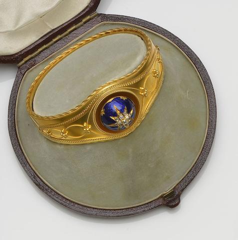 A mid-19th century diamond and enamel hinged bangle