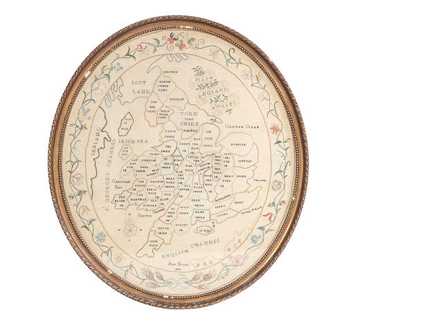 A George III oval needlework map of England and Wales, worked by Ann Brown