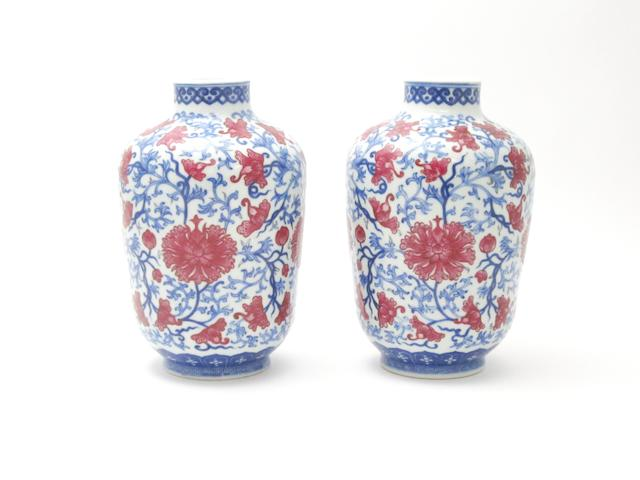 A pair of scrolling lotus vases Bearing Qianlong six-character seal marks