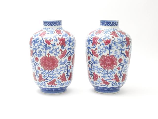A pair of scrolling lotus vases Bearing Qianlong six-character seal marks