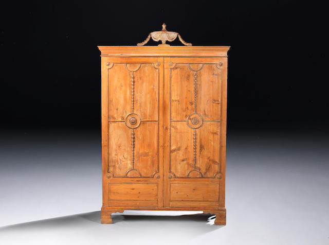 A George III pine wardrobe possibly by Thomas Chippendale