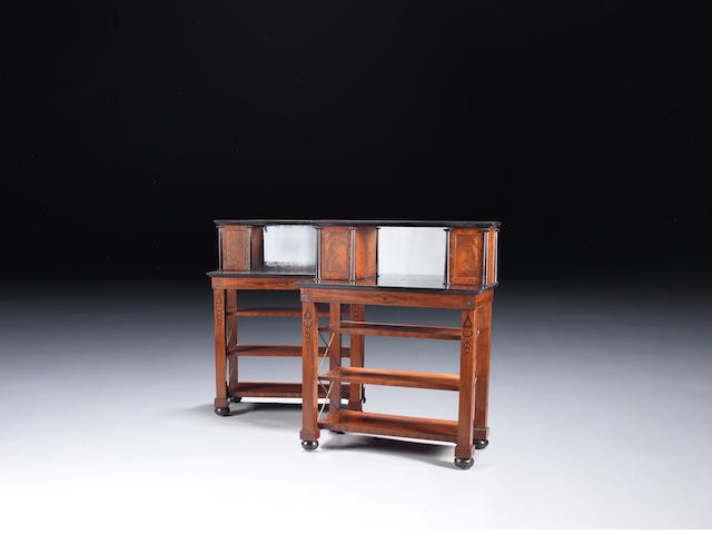 A pair of Regency mahogany, ebonised and black marble side cabinetsin the manner of Marsh and Tatham