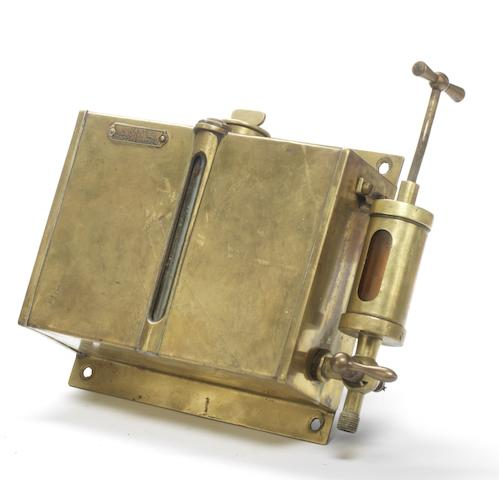 A dashboard mounted oil reservoir by A. Hafter of London and Glasgow,