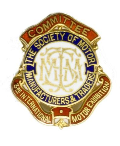 A 3rd Annual International Motor Exhibition gold committee member's enamel lapel badge,