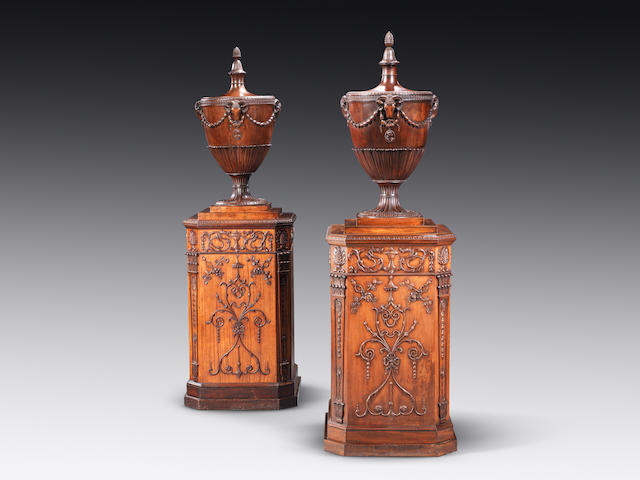 A George III satinwood and carved mahogany dining room pedestal together with a later copy in the manner of Robert Adam