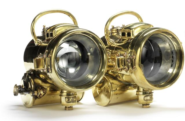 A pair of Powell & Hanmer self-generating acetylene headlamps,