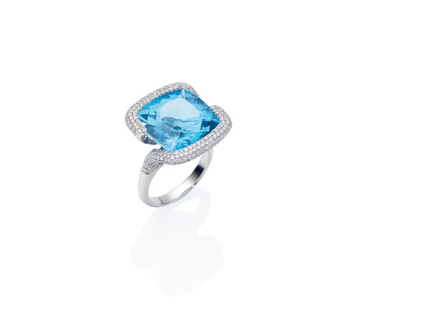 An topaz and diamond dress ring
