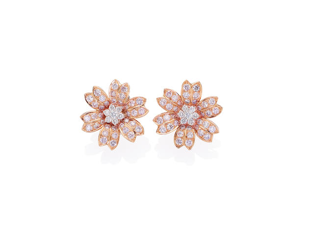 A pair of coloured diamond and diamond earclips