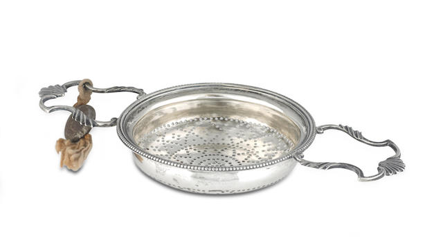 An 18th century silver lemon strainer maker's mark I D, possibly John Deacon, circa 1775