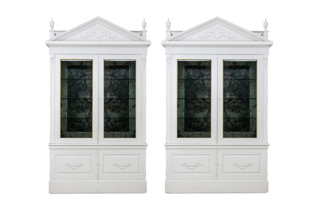 A large pair of Neo-classical design painted bookcases in the George II style