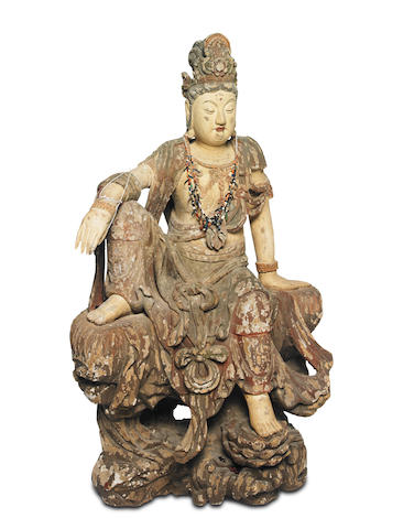 A carved polychrome wood figure of a seated Avalokitesvara, the 'Watermoon' Guanyin, Probably Yuan to Ming dynasty