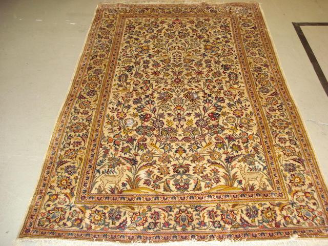 A silk Kashan rug, Central Persia, 214cm x 133cm