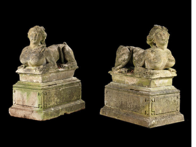 An impressive pair of French mid-18th century carved sandstone sphinges