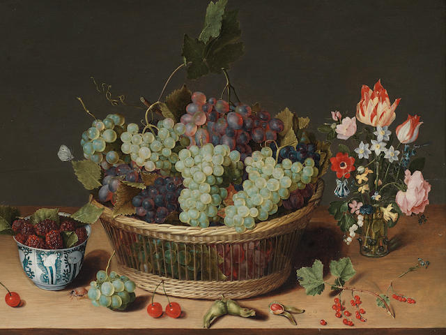 Isaac Soreau (active Hanau 1620-1638) A still life of grapes in a basket, mulberries in a wanli kraak porcelain bowl and flowers in a glass vase on a stone ledge