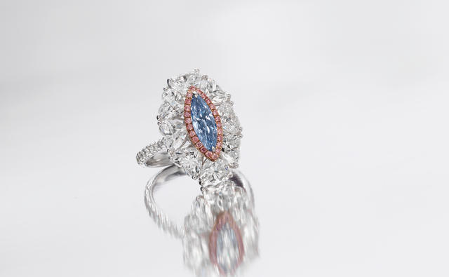 A fancy coloured diamond and diamond dress ring