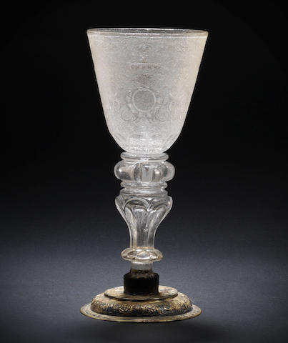 A German engraved goblet on a silver-gilt foot, possibly Gondelach Workshop, early 18th century