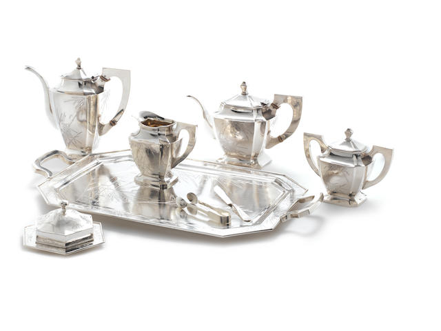 An early 20th century Chinese metalware six-piece tea and coffee service including tray stamped 'S.Co Silver' to the rims with character marks only, circa 1930 (8)