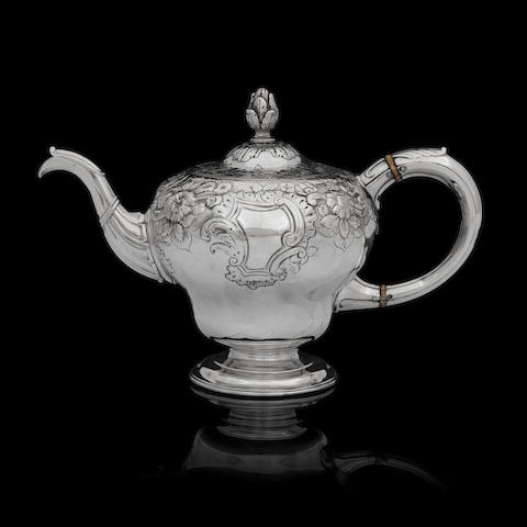 A George II silver teapot by Ker & Dempster, assay master Hugh Gordon, Edinburgh 1751