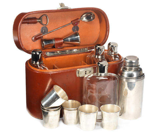 A leather-cased cocktail set for six persons, circa 1910,