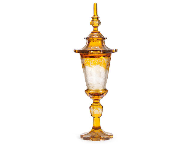 A Bohemian amber-stained goblet and cover, circa 1840-60